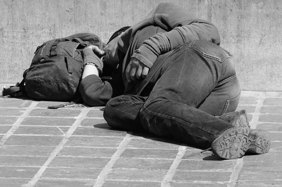 fe4fcc8adf homeless person sleeping outside on hard ground